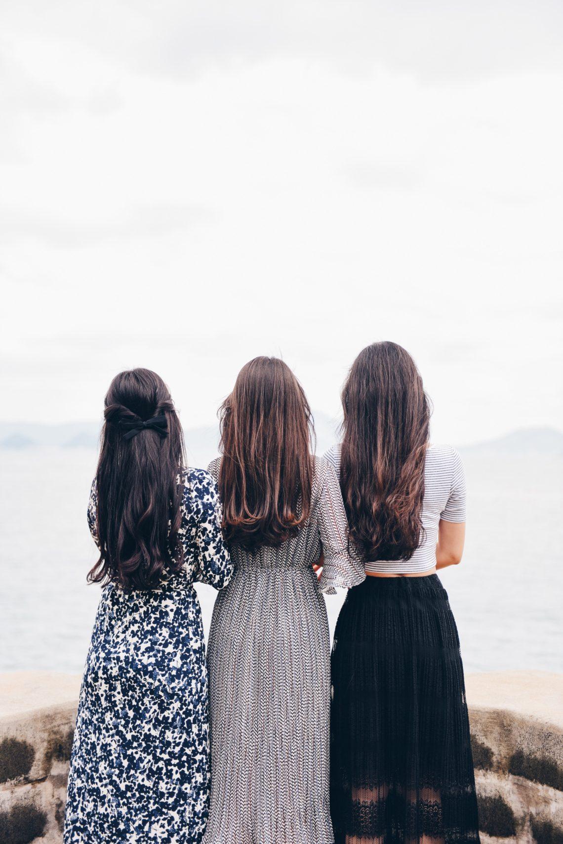 Three women looking at the ocean